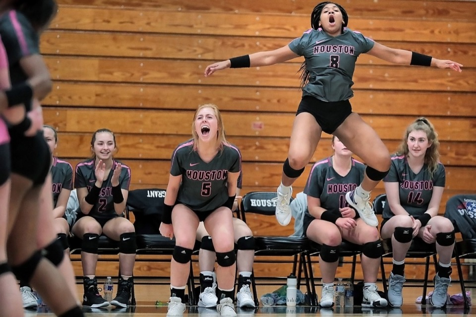 <strong>Houston teammates Brooke Grant (5) and Jordan Jones (8) celebrate a key point during Houston High School's regional finals volleyball win over Collierville at Houston Oct. 15.</strong> (Jim Weber/Daily Memphian)