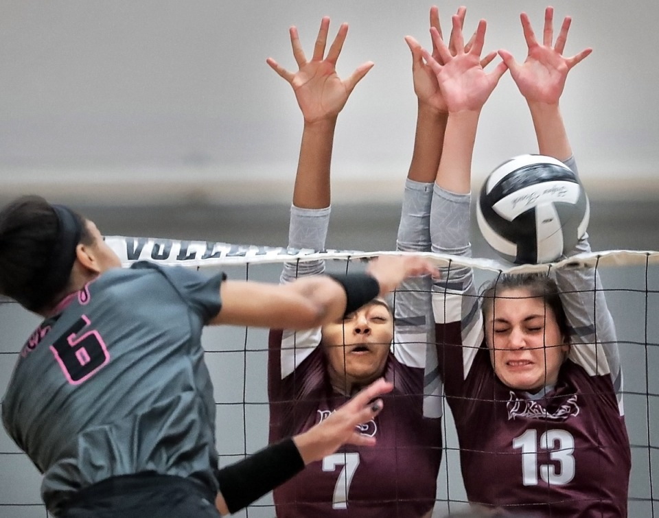 <strong>Collierville's Tia Rizvi (7) and Madison McWhorter (13) block a spike by Houston's Kennedy Shaw (6) during the regional finals Oct. 15.</strong> (Jim Weber/Daily Memphian)