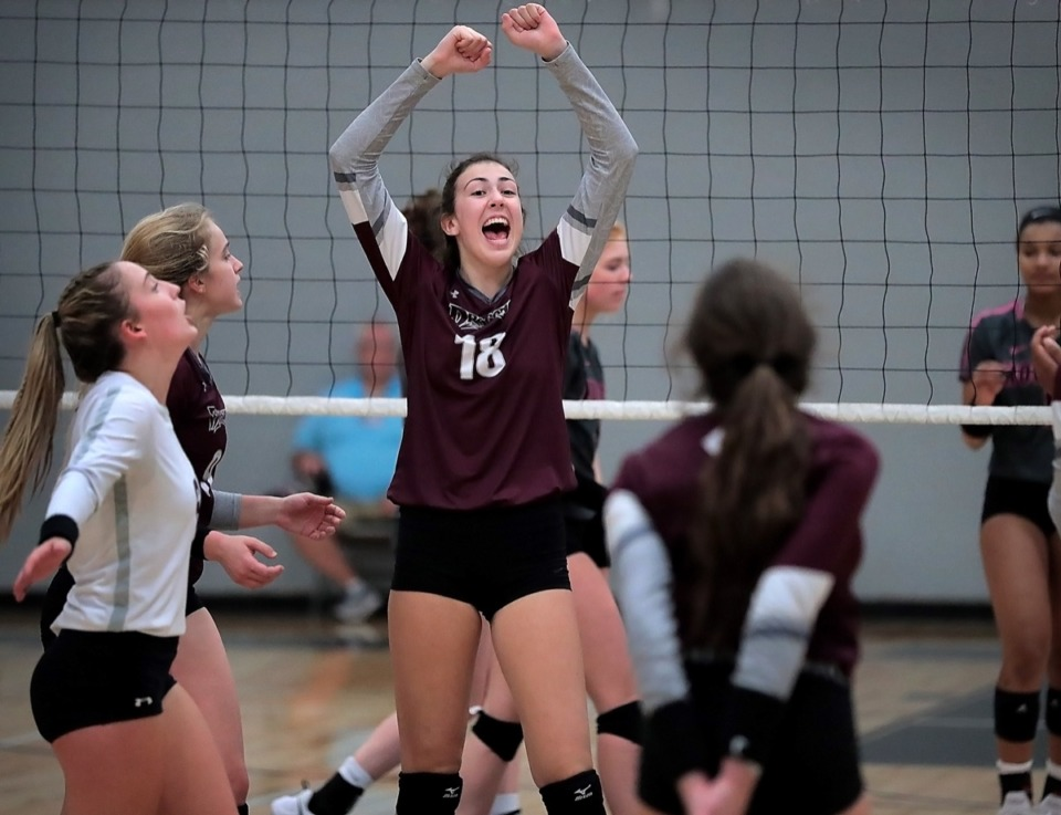 <strong>Collierville's Burdette Brinley (18) celebrates a point during the regional finals at Houston Oct. 15.</strong> (Jim Weber/Daily Memphian)
