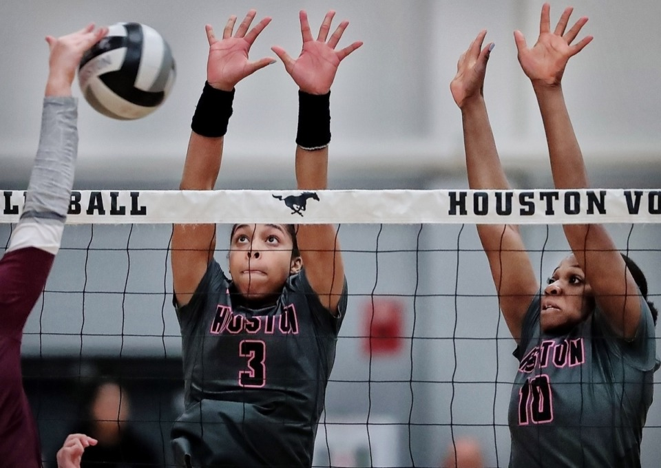 <strong>Houston's Morgan Price (3) and Mariam Morafa (10) block a spike during Houston's regional finals win over Collierville Oct. 15.</strong> (Jim Weber/Daily Memphian)