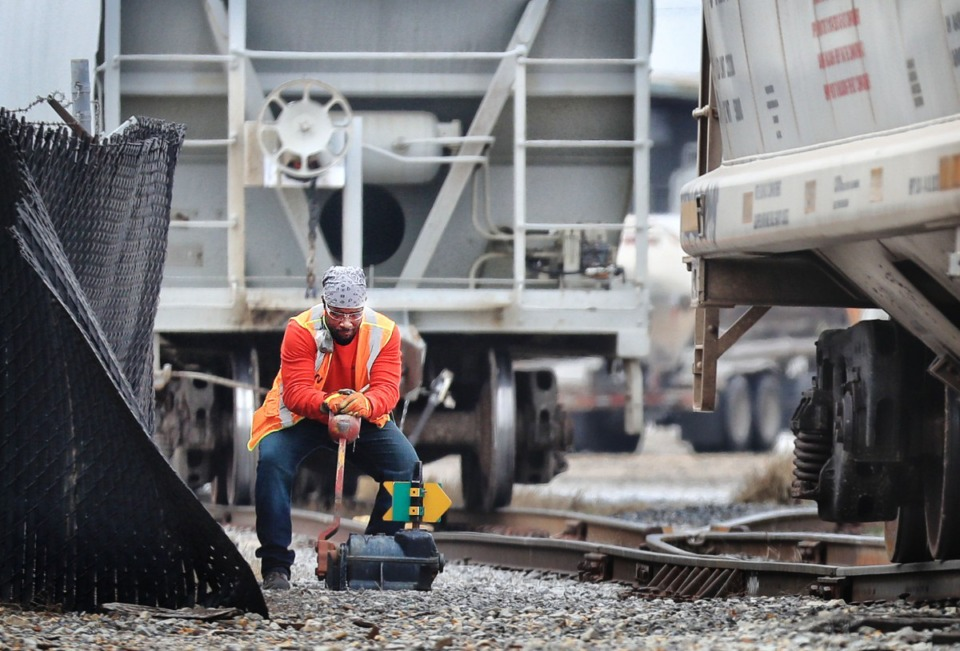 <strong>Freight cars are added to a train on Jan. 16, 2018, near the Transwood Shipping yard and Progress Rail Services on Presidents Island. The Port Commission landed a grant in January to expand rail service to Presidents Island by adding nearly a mile of new track at the public terminal on the island.</strong> (Jim Weber/Daily Memphian file)