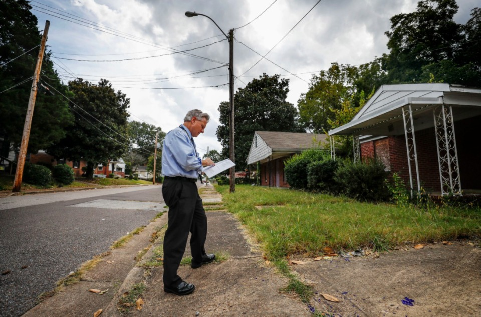 <strong>Steve Shular, City of Memphis special assistant for neighborhood concerns, surveyed vacant homes and blighted areas last week on Red Oak Street in Binghampton.</strong> (Mark Weber/Daily Memphian)