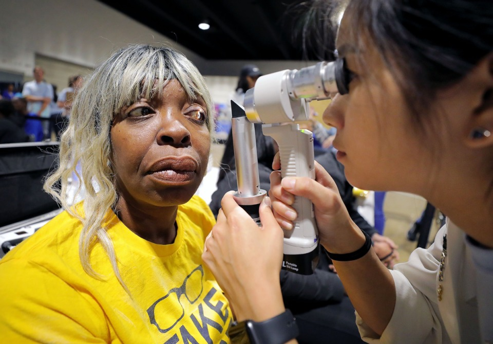 <strong>Sondra Green (left) gets a free eye exam from Southern College of Optometry student Hannah Fann at the Pipkin Building as a part of Project Homeless Connect Oct. 17.</strong> (Patrick Lantrip/Daily Memphian)