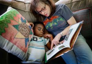 "<strong>Carpenter Art Garden volunteer Jane Pate reads ""Last Stop on Market Street"" to after-school student Javion Hicks, 7.</strong> (Mark Weber/Daily Memphian)"