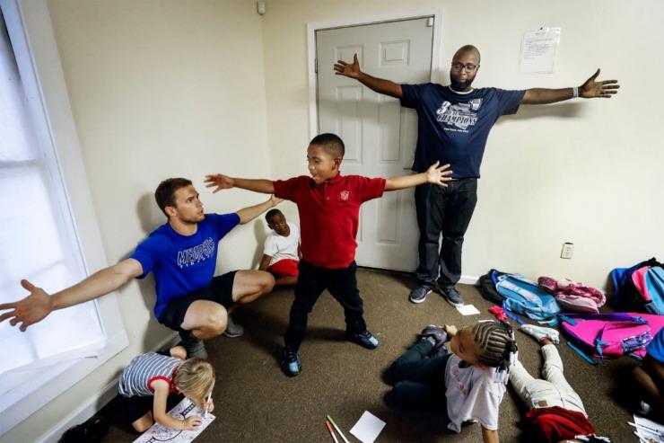 strong>Arthur Jones, 6, (middle) recites a motivational quot