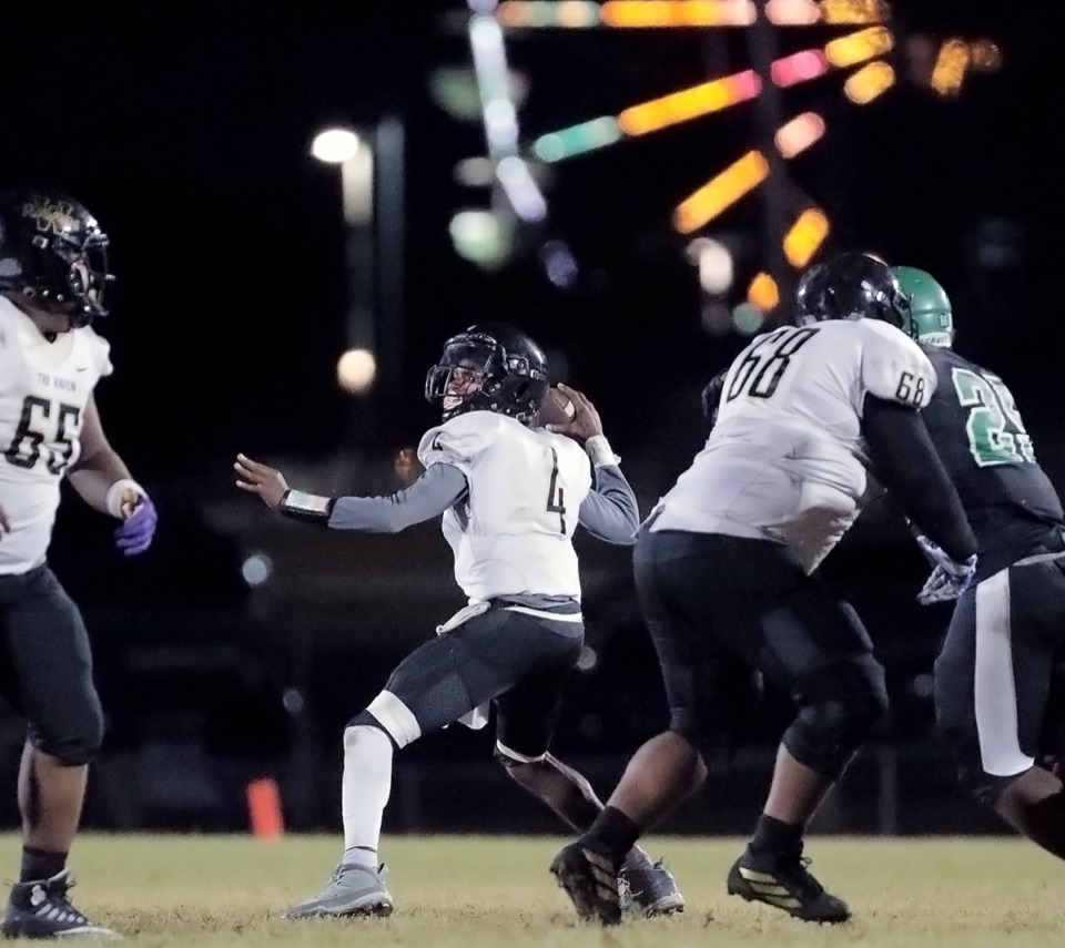 <strong>Quarterback Keyshawn Harris (4, seen here passing against White Station Oct. 11) has yet to throw an interception this year, which is just one of the many reasons Whitehaven (6-1) is ranked No. 1.</strong> (Patrick Lantrip/Daily Memphian)