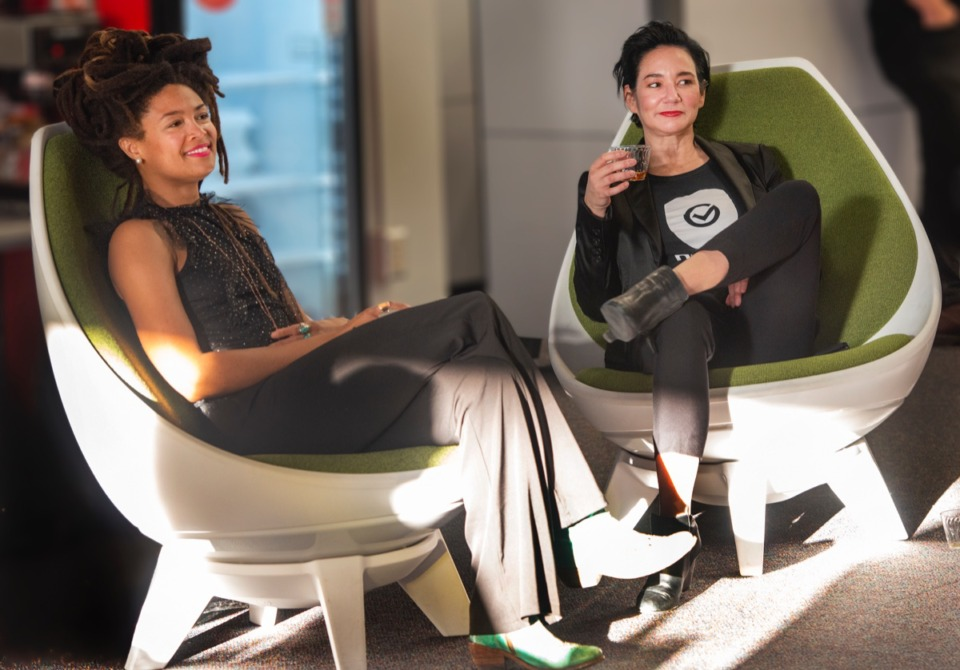 <strong>Valerie June and Maggie Louie, CEO of DEVCON, listen to the Joe Restivo Trio at the open house for DEVCON Oct. 17.</strong> (Greg Campbell/ Special to The Daily Memphian)