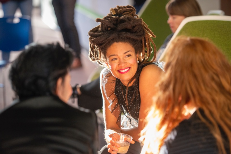 <strong>Native Memphis musician Valerie June talks with attendees of the DEVCON open house Oct. 17.</strong> (Greg Campbell/ Special to The Daily Memphian)