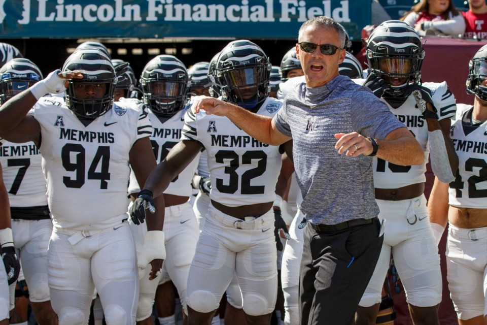 <strong>Memphis head coach Mike Norvell leads his team onto the field as they prepare to face off against Temple on Oct. 12, 2019, in Philadelphia.</strong> (AP Photo/Chris Szagola)