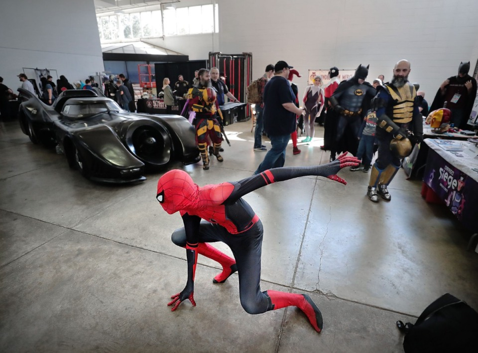 """<strong>Darrell Wilburn strikes his best """"Spidey"""" pose during the annual Memphis Comic Expo at the Agricenter on Oct. 19, 2019. The two-day show features artists, a cosplay contest, a video game tournament and a slew of comic vendors.</strong> (Jim Weber/Daily Memphian)"""