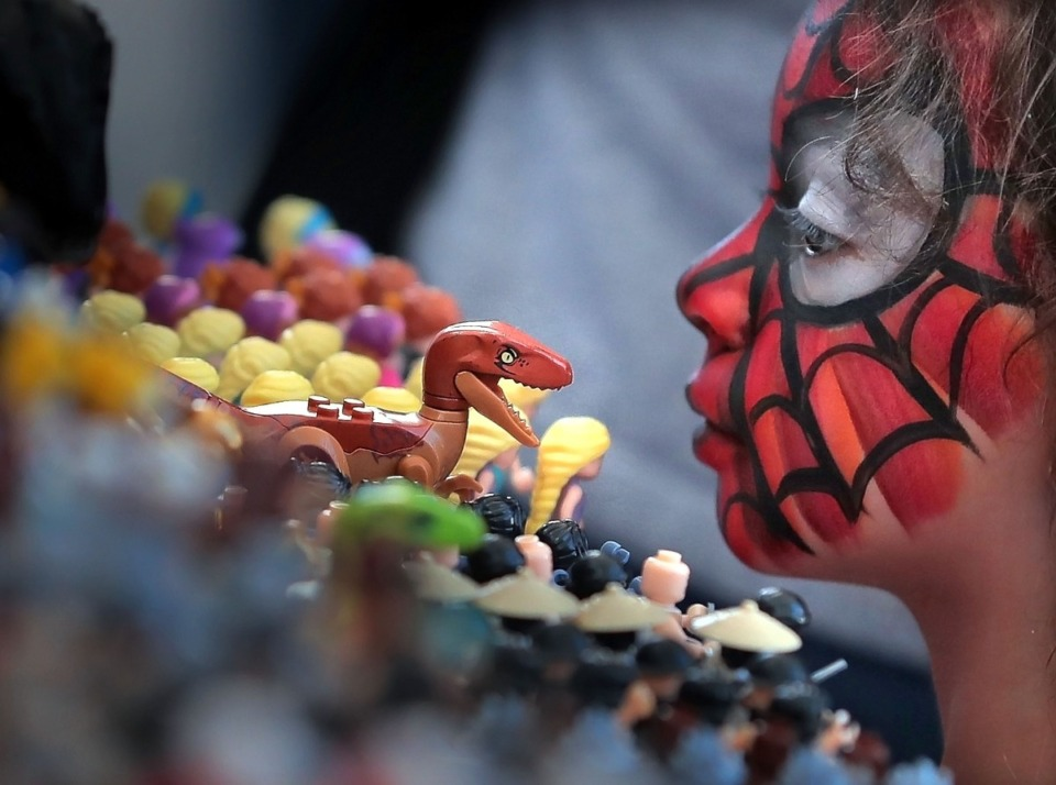 <strong>Skylar Wright, 4, takes a closer look at the army of Lego mini-figures for sale during the annual Memphis Comic Expo at the Agricenter on Oct. 19, 2019. The two-day show features artists, a cosplay contest, a video game tournament and a slew of comic vendors.</strong> (Jim Weber/Daily Memphian)