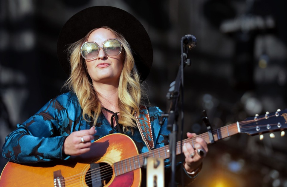 <strong>The sunset over Shelby Farms is reflected in Margo Price's sunglasses as she performs during the second annual Mempho Music Festival at Shelby Farms Park on Oct. 19, 2019.</strong> (Patrick Lantrip/Daily Memphian)