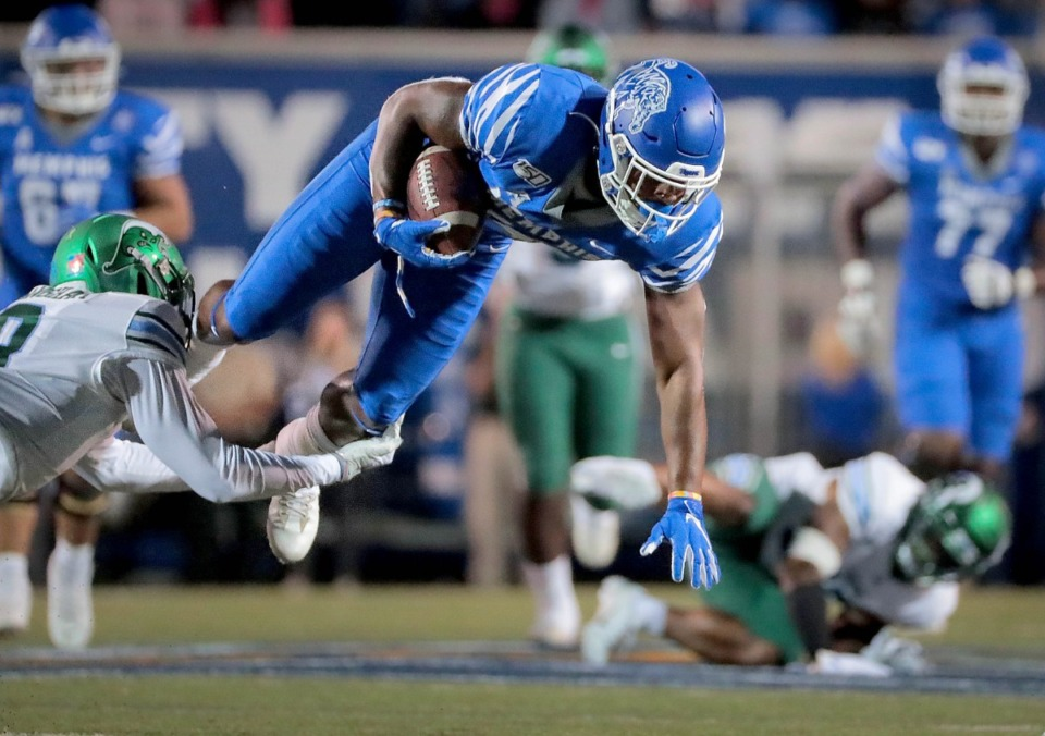 <strong>University of Memphis receiver Antonio Gibson is taken down by Tulane's Willie Langham during the Tigers game on Oct. 19, 2019, against the Green Wave at Liberty Bowl Memorial Stadium in Memphis.</strong> (Jim Weber/Daily Memphian)