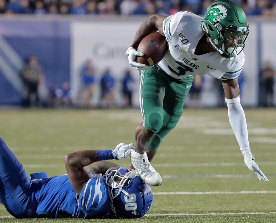 <strong>University of Memphis defensive back T.J. Carter trips up Tulane's P.J. Hall during the Tigers game on Oct. 19, 2019, against the Green Wave at Liberty Bowl Memorial Stadium in Memphis.</strong> (Jim Weber/Daily Memphian)
