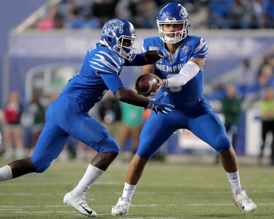 <strong>University of Memphis quarterback Brady White (right) shuffles the ball to running back Kylan Watkins during the Tigers game on Oct. 19, 2019, against the Green Wave at Liberty Bowl Memorial Stadium in Memphis.</strong> (Jim Weber/Daily Memphian)