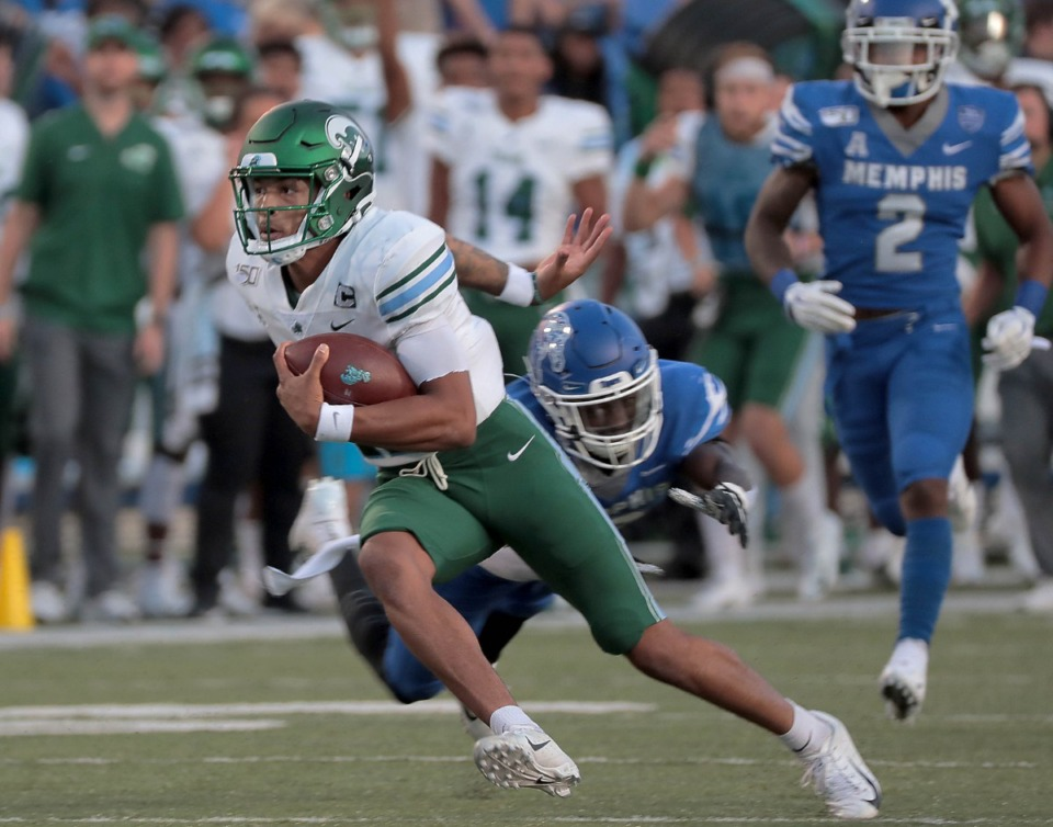 <strong>Tulane quarterback Justin McMillan dodges a University of Memphis tackle during the Tigers game on Oct. 19, 2019, against the Green Wave at Liberty Bowl Memorial Stadium in Memphis.</strong> (Jim Weber/Daily Memphian)