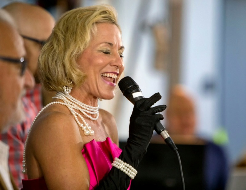 "<strong>Sharon Fryman does her best Madonna impression, singing ""Material Girl"" as a way to coax charitable donations from the crowd during H Saga/Port Alliance's annual Cookout and Karaoke For a Cause in Arlington on Oct. 18, 2019.</strong> (Mike Kerr/Special to Daily Memphian)"