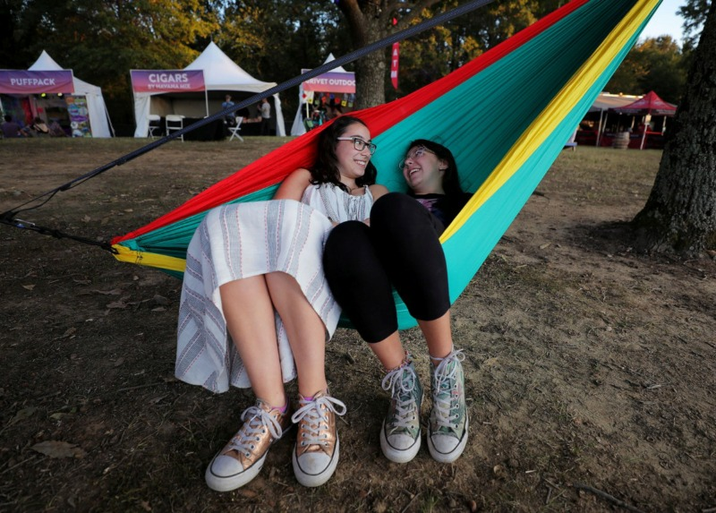 <strong>McKenna Hall (left) and Katie Dora Silkes (right) joke with each other while lounging in a hammock during the third annual Mempho Music Festival at Shelby Farms on Oct. 19, 2019.</strong> (Patrick Lantrip/Daily Memphian)