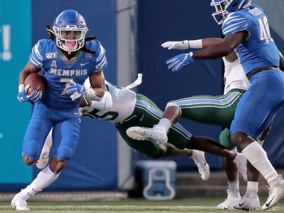 <strong>University of Memphis' Chris Claybrooks dodges Tulane defenders on a punt return during the Tigers game on Oct. 19, 2019, against the Green Wave at Liberty Bowl Memorial Stadium in Memphis.</strong> (Jim Weber/Daily Memphian)