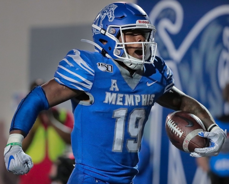 <strong>University of Memphis running back Kenneth Gainwell celebrates after running in for a touchdown during the Tigers game on Oct. 19, 2019, against the Green Wave at Liberty Bowl Memorial Stadium in Memphis.</strong> (Jim Weber/Daily Memphian)
