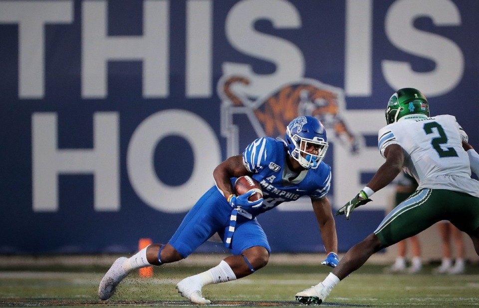 <strong>University of Memphis receiver Antonio Gibson regains his footing after a reception during the Tigers game on Oct. 19, 2019, against the Green Wave at Liberty Bowl Memorial Stadium in Memphis.</strong> (Jim Weber/Daily Memphian)