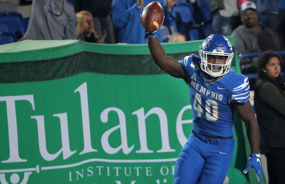<strong>University of Memphis linebacker Thomas Pickens (40) celebrates after intercepting a Tulane pass Saturday at Liberty Bowl Memorial Stadium in Memphis.</strong> (Jim Weber/Daily Memphian)