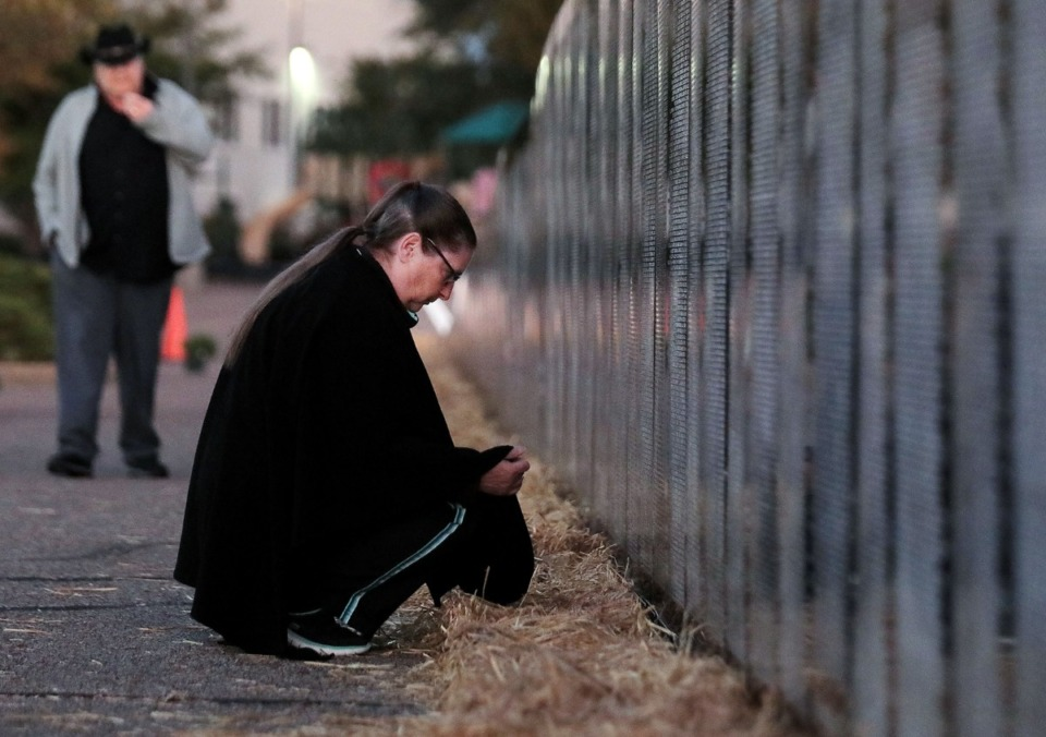 <strong>Ellie Vinson reflects in front of the Vietnam Traveling Memorial Wall in Collierville.</strong>&nbsp;<strong>The wall, which is illuminated around the clock, will remain at Central Church until Monday morning.</strong> (Patrick Lantrip/Daily Memphian)