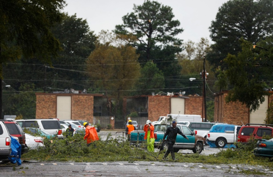 <strong>Workers clear storm damage at the Cottonwood Apartments after heavy rains and high winds hit the Parkway Village area early Monday, Oct. 21, 2019.</strong> (Mark Weber/Daily Memphian)