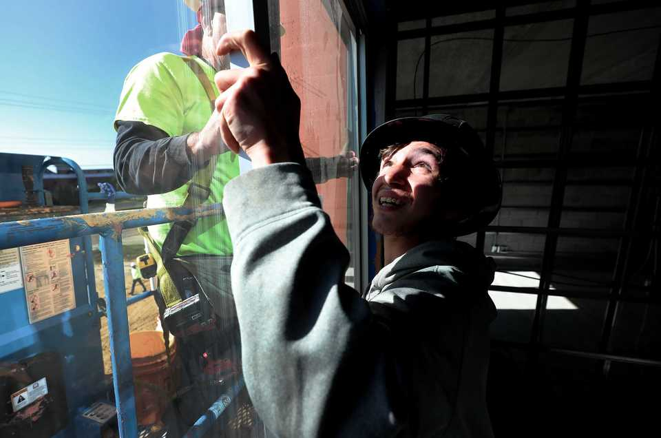 <strong>Jacob Thigpen, an employee at Circle G Glass Co., installs a window in one of the bedrooms in the soon-to-be Fairfield Inn &amp; Suites across the street from Carriage Crossing in Collierville. </strong>&nbsp;(Houston Cofield/Daily Memphian)
