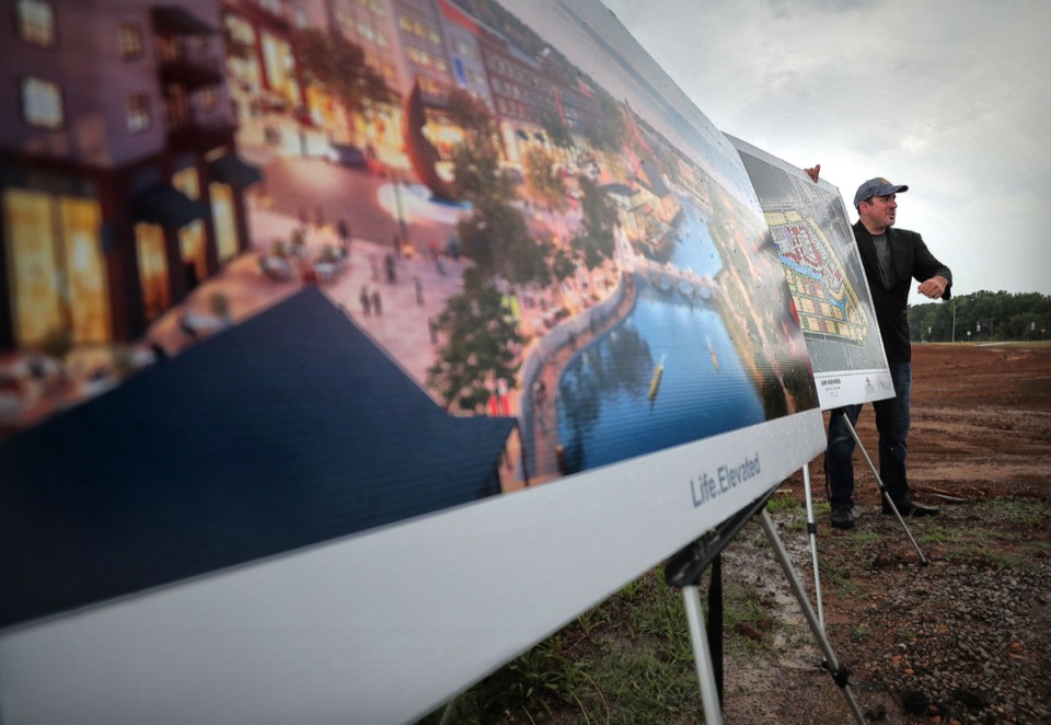 <strong>Lakleland commissioner Wesley Wright displays Lake District plans at a June 4 press conference near the intersection of I-40 and Canada Road.</strong> (Jim Weber/Daily Memphian)