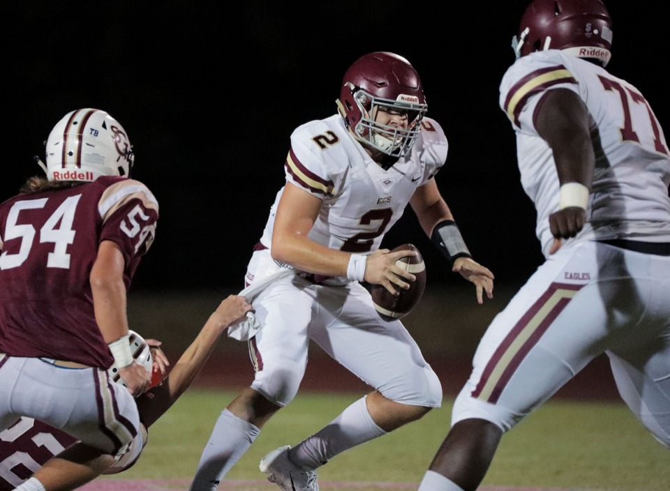 <strong>Evangelical Christian Football junior quarterback Jacob Hatcher (2) shakes off a St. George's defender Oct. 18.</strong>&nbsp;<strong>ECS is 7-1 and plays Munford next, on Oct. 25.</strong> (Patrick Lantrip/Daily Memphian)