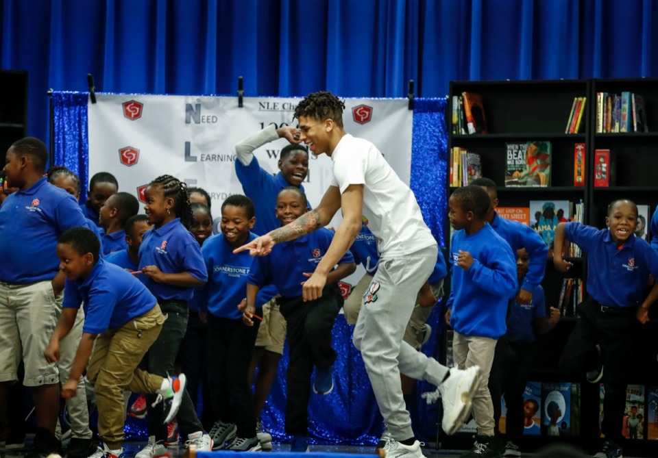 <strong>Memphis rapper NLE Choppa (center) performs his signature dance move with students at Cornerstone Prep in Frayser Oct. 22, after launching a new education initiative to encourage and reward students to increase reading rates.</strong> (Mark Weber/Daily Memphian)