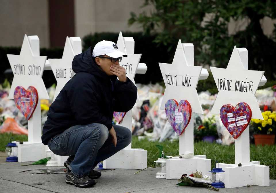 <span><strong>A person pauses on Monday, Oct. 29, 2018, in front of Stars of David with the names of those killed in a deadly shooting at the Tree of Life Synagogue in Pittsburgh.</strong> (AP Photo/Matt Rourke)</span>
