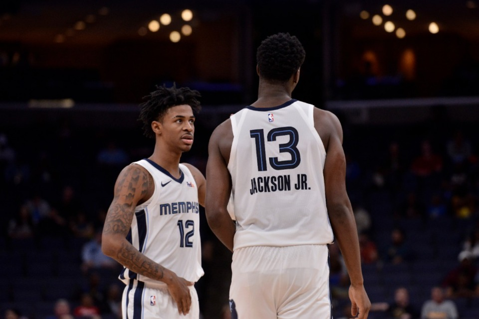 <strong>Memphis Grizzlies guard Ja Morant (12) and forward Jaren Jackson Jr. (13) talk in the first half of an exhibition NBA basketball game against the New Zealand Breakers Oct. 8.</strong>&nbsp;(Brandon Dill/AP)