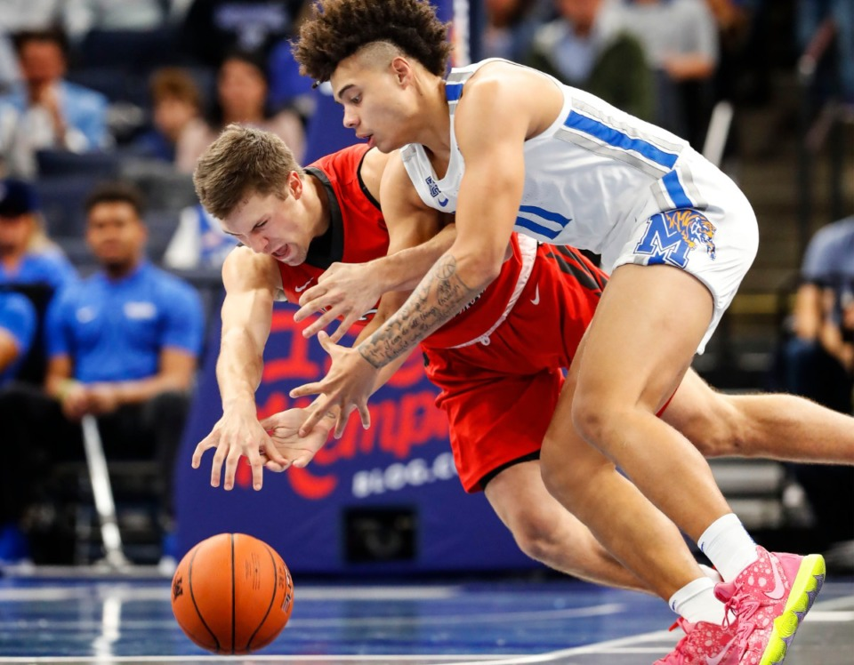 <strong>Memphis guard Lester Quinones (right) battles CBU defender Nick Deifel for a loose ball Oct. 24 at FedExForum.</strong> (Mark Weber/Daily Memphian)