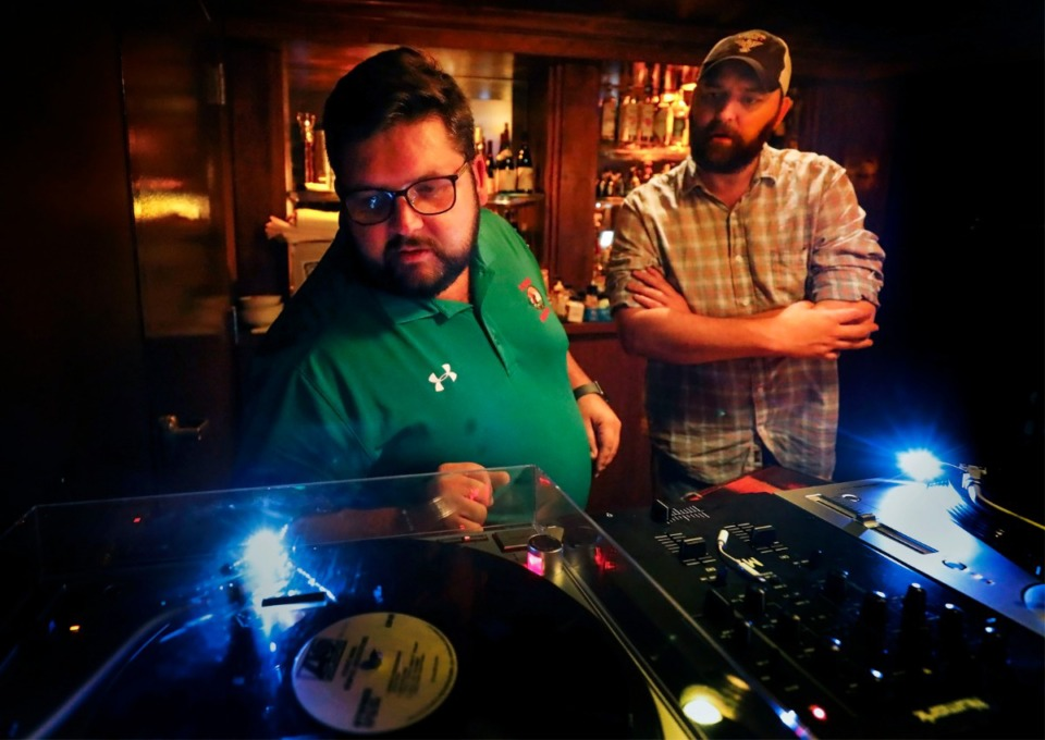 <strong>The Lounge at 3rd &amp; Court Diner owner Ryan Trimm (left) and General Manager Dougan Grimes look over their selection of vinyl records Oct. 24. The basement bar will feature Memphis-style music in a speakeasy-style lounge.</strong> (Mark Weber/Daily Memphian)