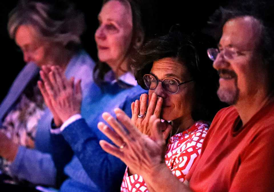 <strong>Carol Buchman (center) reacts to music played during The Mystic, a monthly interfaith gathering held at Crosstown Arts Tuesday, Oct. 30. The event included a panel discussion that touched on inclusivity and acceptance following the Oct. 27 mass shooting at a Pittsburgh synagogue.&nbsp;</strong>(Houston Cofield/Daily Memphian)