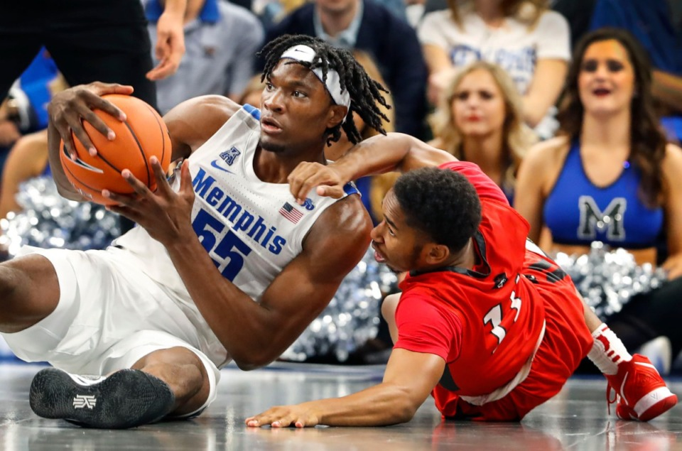 <strong>Tiger Precious Achiuwa (left) is fouled by CBU guard Malik Jones Oct. 24.</strong> (Mark Weber/Daily Memphian)