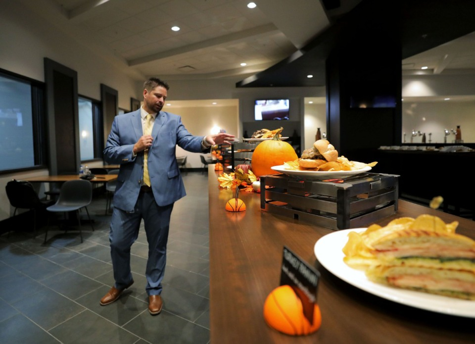 <strong>Josh Smallie, director of operations at Levy Restaurants, shows some of the enhanced food and dining options that will be available for the upcoming Memphis Grizzlies season.</strong> (Patrick Lantrip/Daily Memphian)