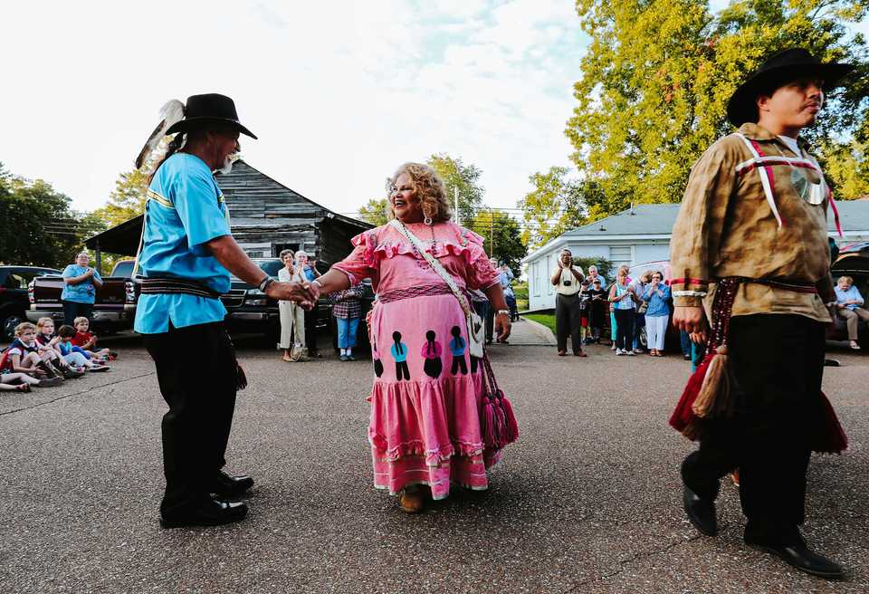 <strong>Jesse Lindsey (left) and LaDonna Brown, dance partners in the Chickasaw Dance Troupe, shake hands after performing a traditional Chickasaw tribal dance outside the DeSoto County Museum. The dance troupe is a part of the Chickasaw Inkana Foundation and makes homeland tours around the U.S. in an effort to educate and preserve Chickasaw history and culture.</strong> (Houston Cofield/Daily Memphian)