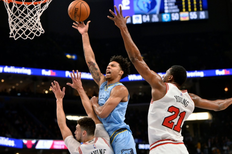 <strong>Memphis Grizzlies forward Brandon Clarke (center) shoots between Chicago Bulls guard Zach LaVine (left) and forward Thaddeus Young (21) Oct. 25.</strong> (Brandon Dill/AP)