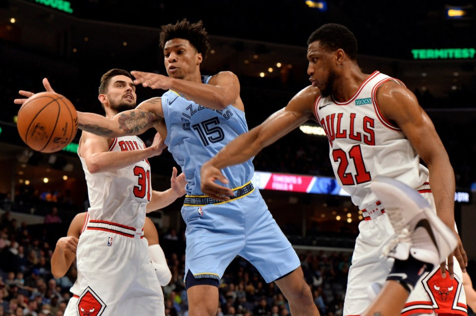 <strong>Memphis Grizzlies forward Brandon Clarke (15) struggles to control the ball between Chicago Bulls guard Tomas Satoransky (31) and forward Thaddeus Young (21) Oct. 25 at FedExForum.</strong> (Brandon Dill/AP)