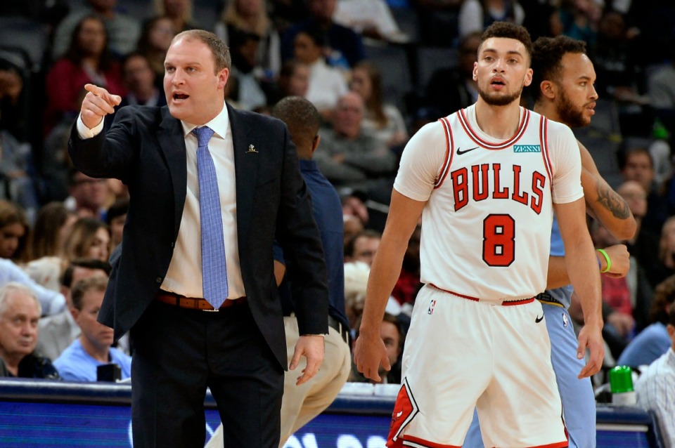 <strong>Memphis coach Taylor Jenkins (left) charges past Chicago Bulls guard Zach LaVine (8) to challenge a call Oct. 25.</strong> (Brandon Dill/AP)