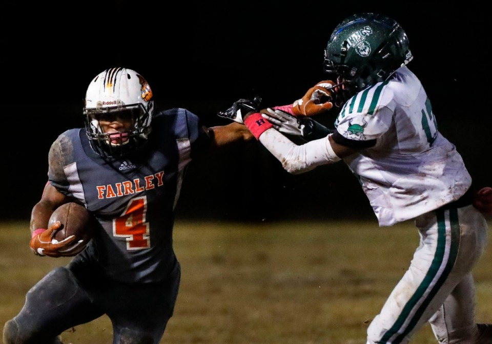 <strong>Fairley running back Terry Wilkins (with ball) scrambles past Hillcrest defender Danaye Seay Oct. 25.</strong> (Mark Weber/Daily Memphian)