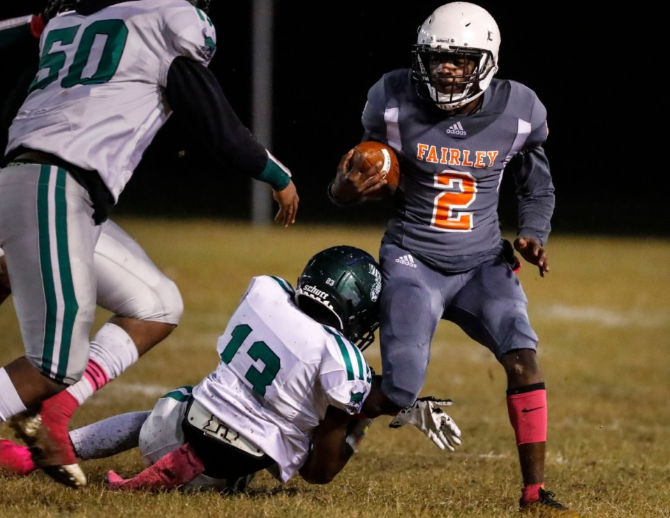 <strong>Fairley receiver Thomas Vaughn (2, with ball) is tackled by Hillcrest defender Danaye Seay (bottom) as Jerren Jordan (left) helps on the play Oct. 25.</strong> (Mark Weber/Daily Memphian)