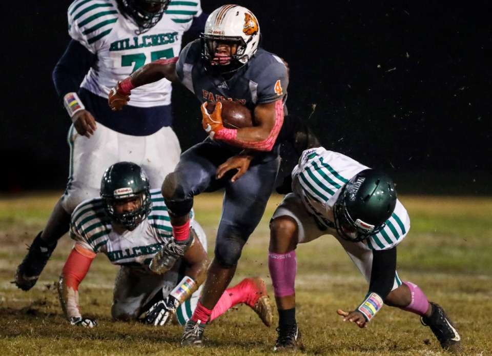 <strong>Fairley running back Terry Wilkins (with ball) scrambles past the Hillcrest defense Oct. 25.</strong> (Mark Weber/Daily Memphian)
