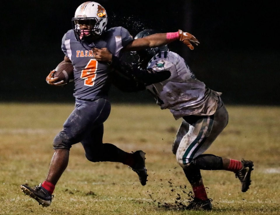 <strong>Fairley running back Terry Wilkins (with ball) is pursued by Hillcrest's Corvant Parker Oct. 25.</strong> (Mark Weber/Daily Memphian)