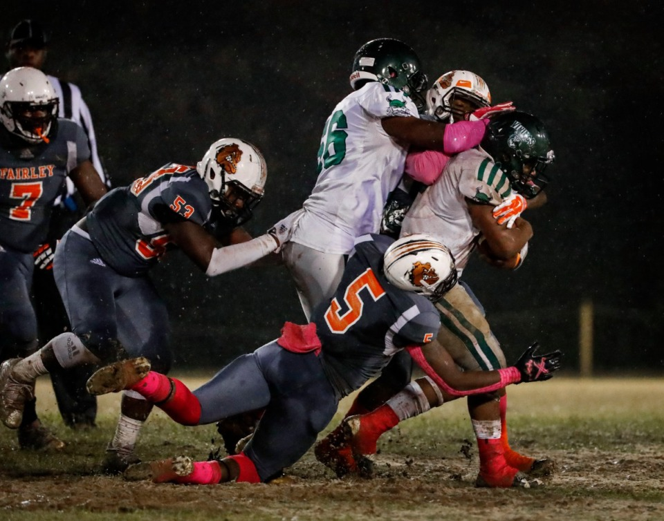 <strong>Hillcrest running back Keshun Parker (right) is tackled in the game against Fairley Oct. 25.</strong> (Mark Weber/Daily Memphian)