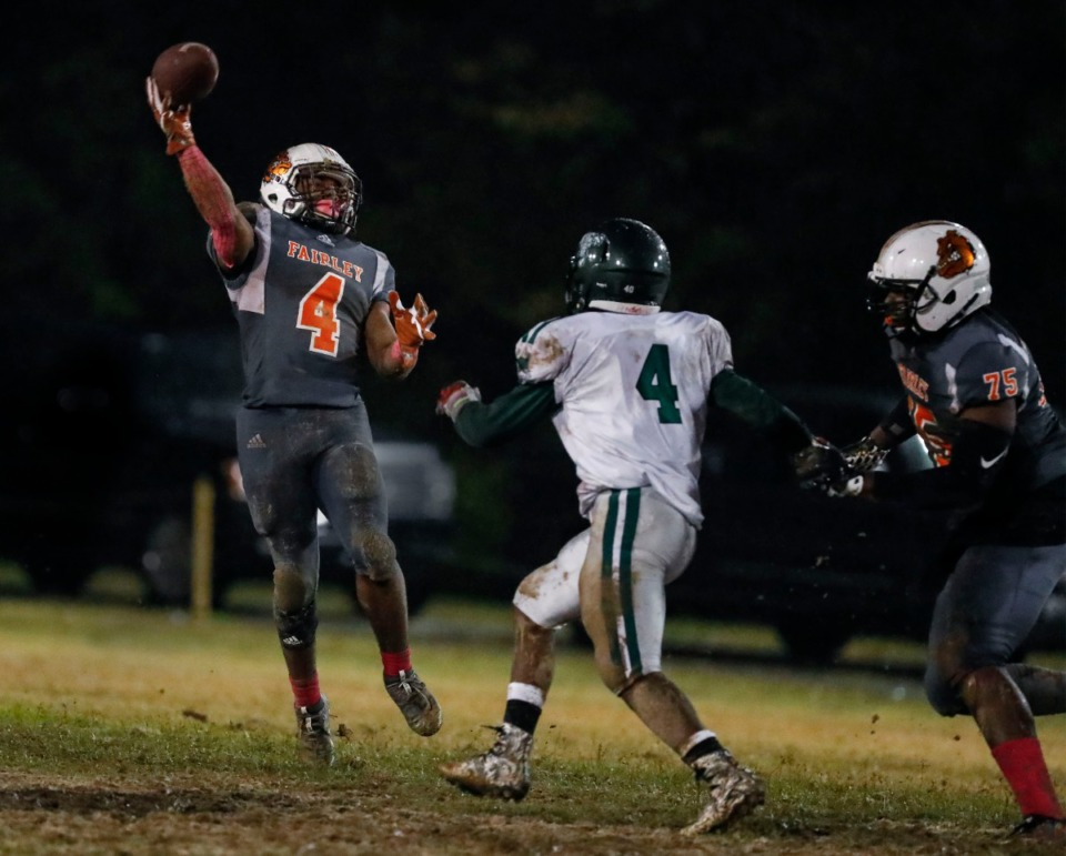 <strong>Fairley running back Terry Wilkins (with ball) makes a halfback pass against Hillcrest Oct. 25.</strong> (Mark Weber/Daily Memphian)