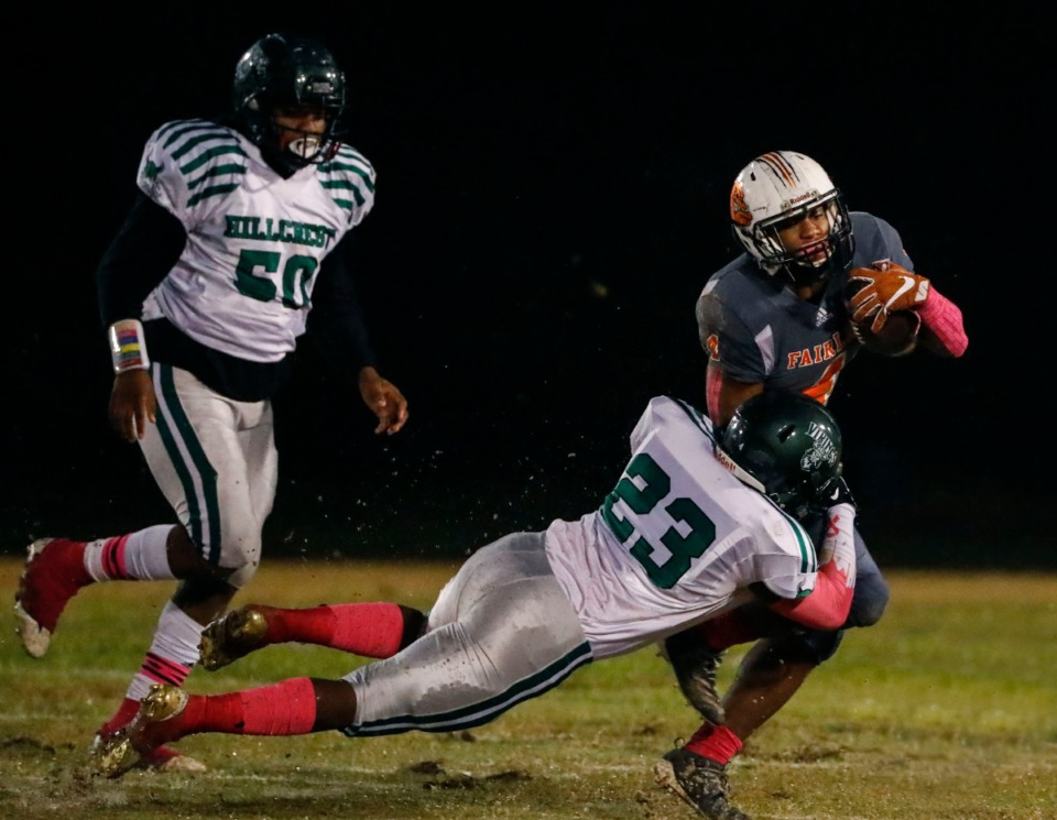 <strong>Fairley's Terry Wilkins (right) is tackled by Hillcrest's Corvant Parker (center), assisted by&nbsp;Jerren Jordan, during a punt return Oct. 25.</strong> (Mark Weber/Daily Memphian)